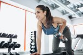 Young Beautiful Woman Doing Exercises With Dumbbell In Gym. poster