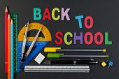 Mathematical Instruments Over The Corner Of Black Paper With Text Back To School. Back To School Wit poster