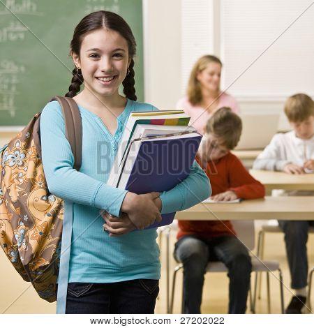 Student mit Rucksack und Bücher