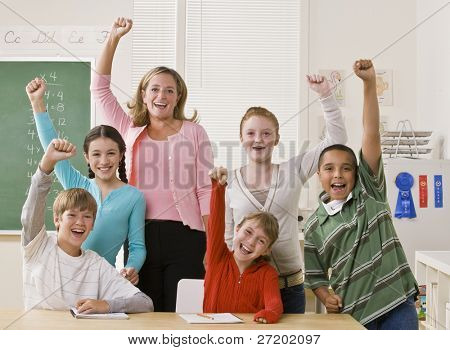 Teacher and students cheering