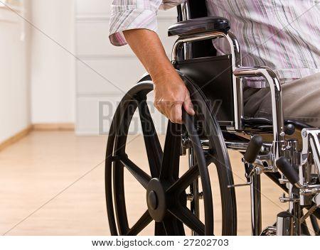 Senior Woman sitting in Rollstuhl