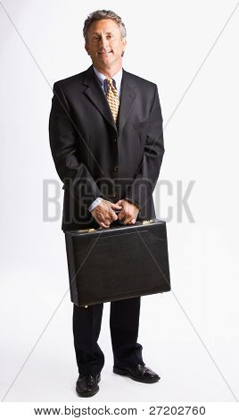 Businessman carrying briefcase