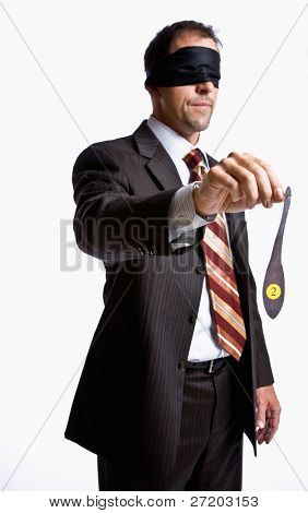 Businessman in blindfold with donkey tail