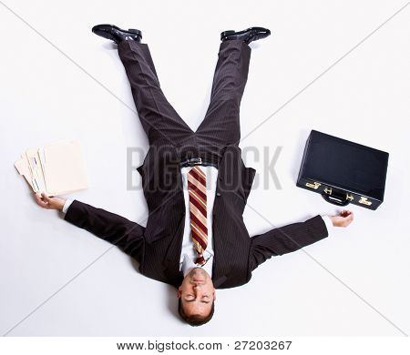 Businessman laying on floor and briefcase
