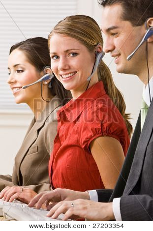 Business people talking on headsets