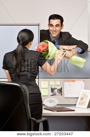 Businessman giving co-worker flowers