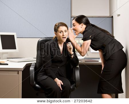 Co-workers gossiping