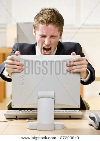 Businessman shouting at computer