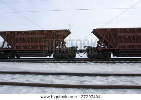 Railway trucks rush on rails