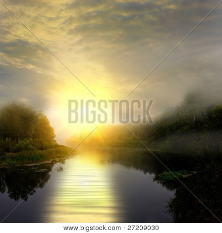 Landscape with sunset on foggy river