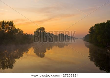 Early morning on river before sunrise