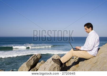 Working With The Laptop At The Beach