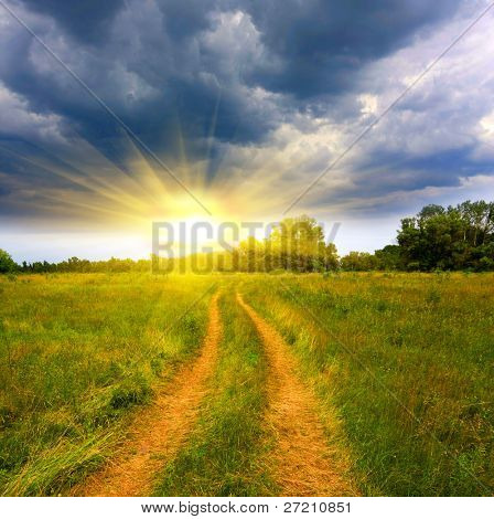 Landscape with rural road in steppe in evening time