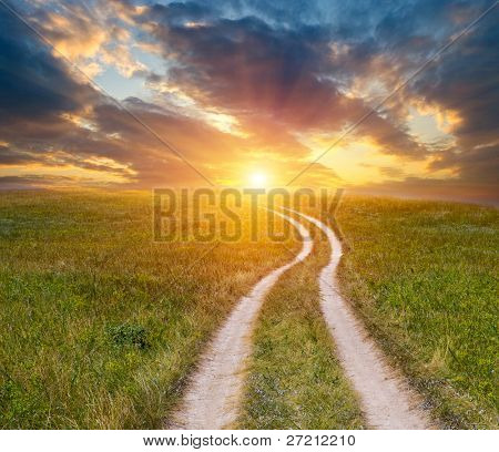 Road in steppe to sunset