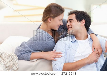 In love couple embracing each other in their living room