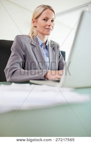 Young businesswoman working on her notebook