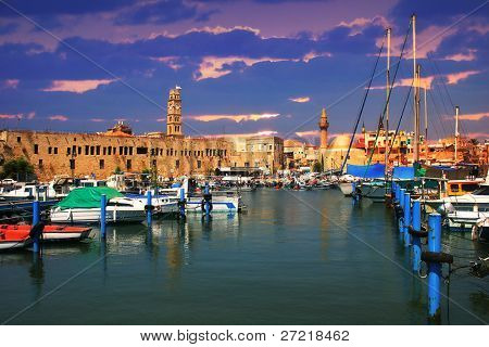 View on marina with yachts and ancient walls of harbor in Acre, Israel.