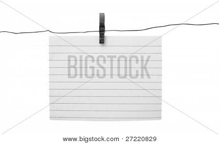 Blank piece of paper hang on clothesline on sky background