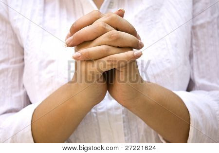 Hands Positioned as in Prayer isolated on white