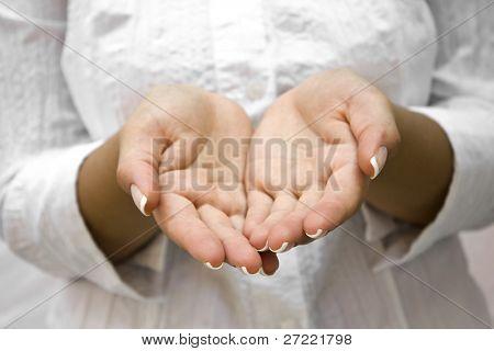 Open hands hopefully held up high