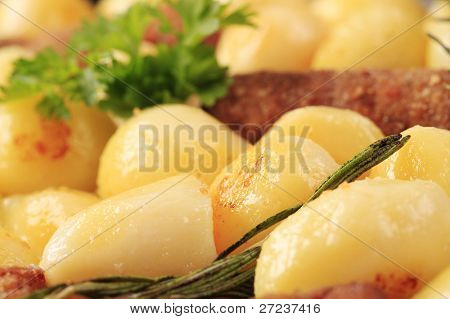 Detail of pan-roasted potatoes and minced meat kebabs