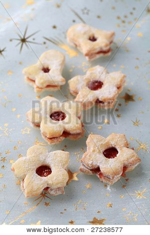 Flower/ bell jam shortbread cookies on a festive table cloth