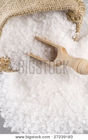 Sea salt crystals on a wooden spoon