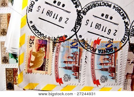 RUSSIA -CIRCA 2009: A stamp printed in the USSR shows russian simbols -Moscow Kremlin and brown bear, circa 2009