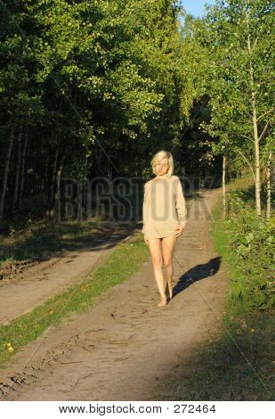 Girl Wolking Along The Forest Ground