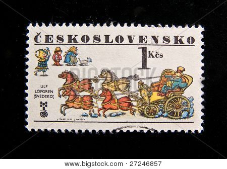 CZECHOSLOVAKIA - CIRCA 1977: A stamp printed in Czechoslovakia showing landowner horse cart, fool, old man, old woman and a cat, circa 1977