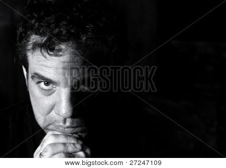 Black and white portrait of a pensive man