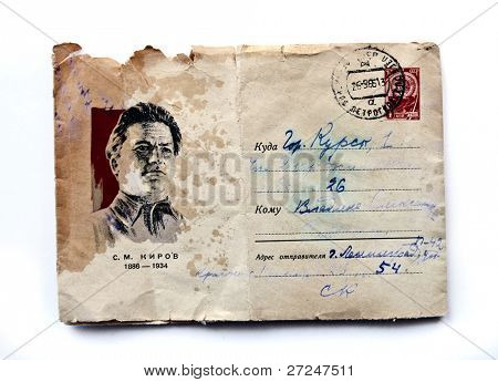 USSR- CIRCA 1961: Envelope printed in the USSR shows portrait of the Soviet party leader, Sergei Kirov, a Communist and a postage stamp with the image of the Soviet emblem, circa 1961