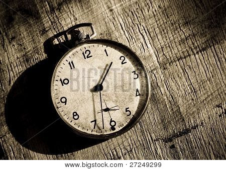 Time stopped. The old clock on the grunge background
