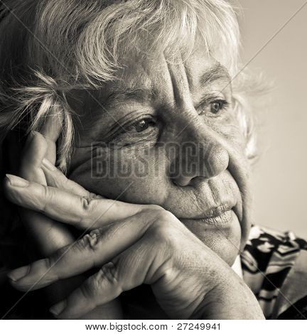 Black and white portrait of a pensive elderly woman