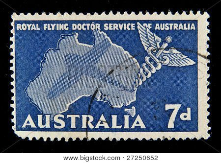 AUSTRALIA - CIRCA 1959: A stamp printed in Australia shows symbols of the royal flying doctor service of Australia, circa 1959
