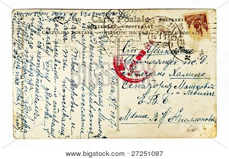 RUSSIA - CIRCA 1917: The old envelope with the royal postage stamp and handwritten letter, circa 1917