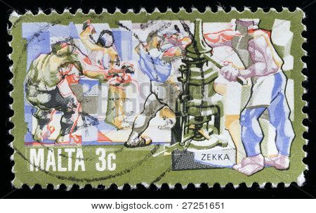 MALTA - CIRCA 1980-th: A stamp printed in Malta shows devises metal smiths, circa 1980-th