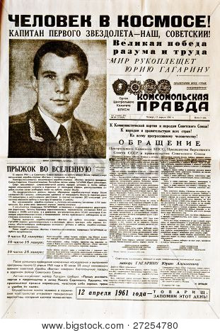 "MOSCOW, USSR - APRIL 13: Soviet newspaper ""Komsomolskaya Pravda "" with reporting about first manned flight in space and Yury Gagarin's portrait, on  April 13, 1961 in Moscow, USSR"