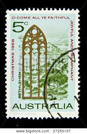 AUSTRALIA - CIRCA 1968: A Christmas stamp printed in Australia shows View of Bethlehem and Church Window, circa 1968