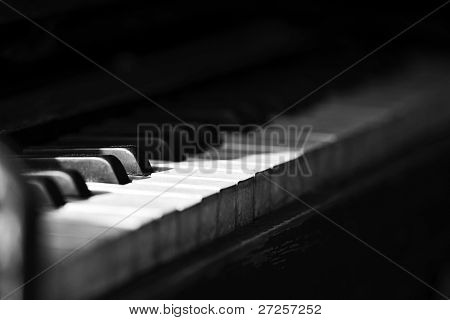 Piano side view with keys lost in the light.