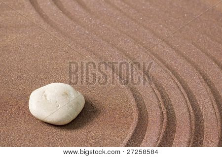 zen garden of sand and stones with copy-space