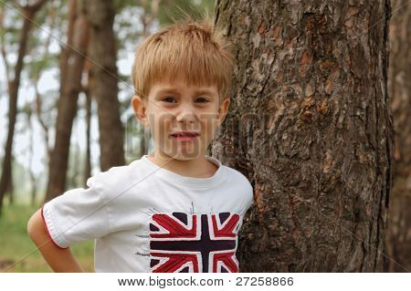 sad little boy going to cry nature outdoor