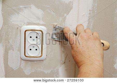 putty near wall outlet - renovation indoor