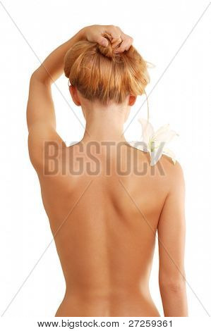 back of nude beautiful girl with flower isolated on white background