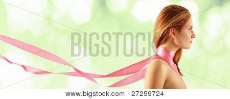 woman young beautiful with pink ribbon over light green background