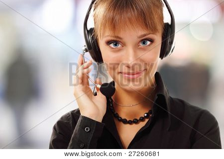 Support phone operator beautiful young woman in headset at workplace