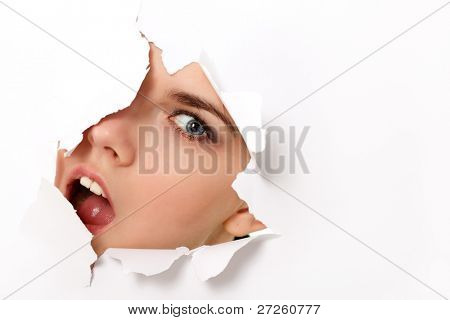 peeping teen girl surprised through hole in paper