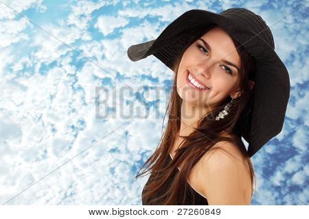 summer teen girl cheerful in panama and  sunglasses enjoying over sky background
