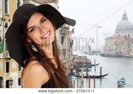 summer teen girl cheerful in panama and  sunglasses enjoying over Venice background