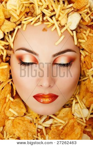 woman beauty face victim of unhealthy eating fast food potato chips rusk frame